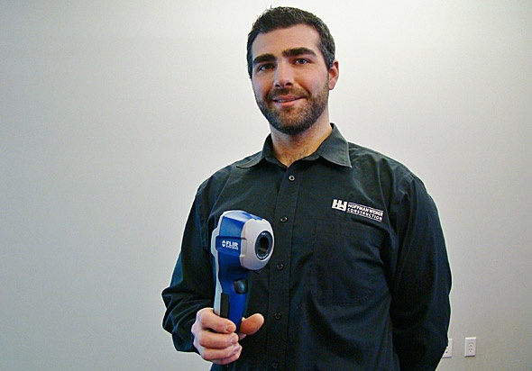 employee with infrared scanner