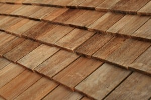 Diagonal detail of brown wood roof shingles