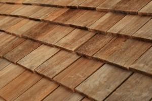 Diagonal detail of brown wood roof shingles