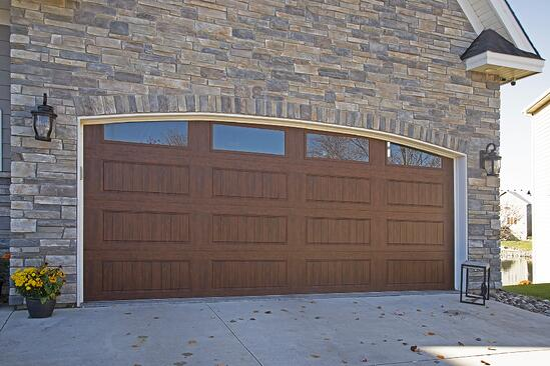 custom wood garage door and stone