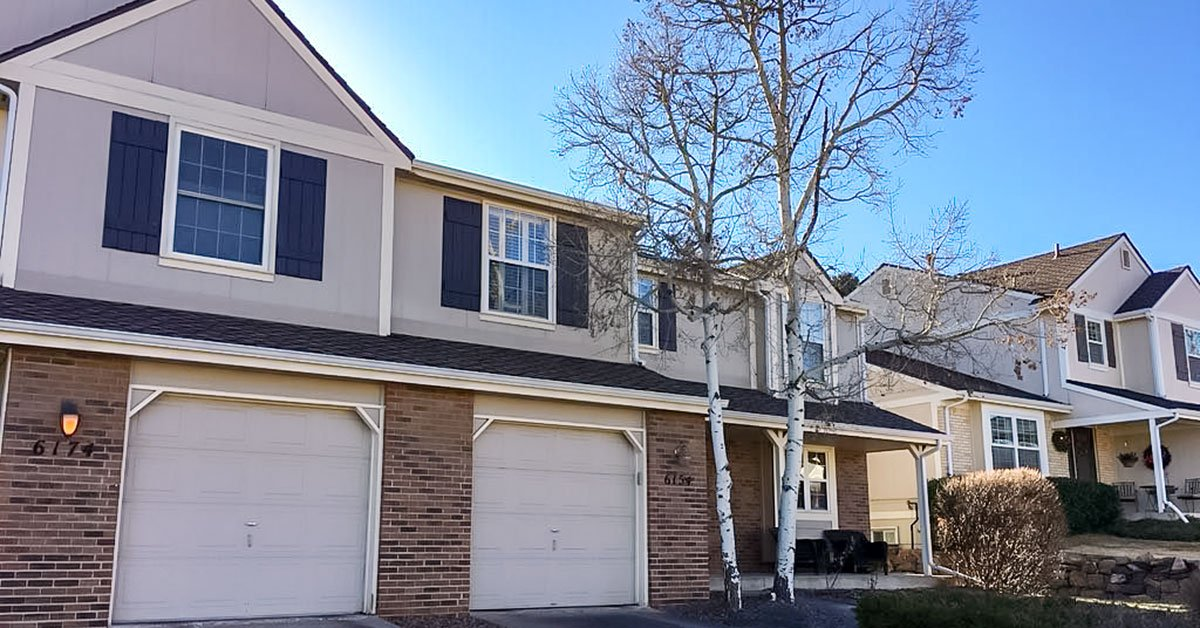 Mill Creek multifamily homes before siding restoration project